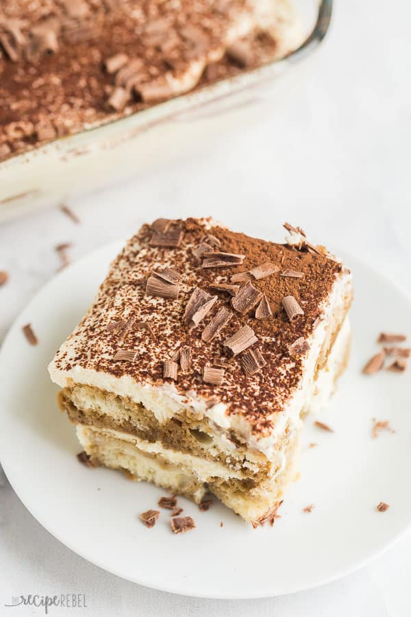 tiramisu recipe slice on plate on white background