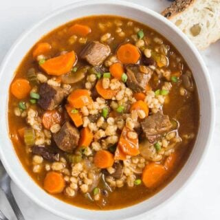 beef and barley soup in a bowl overhead