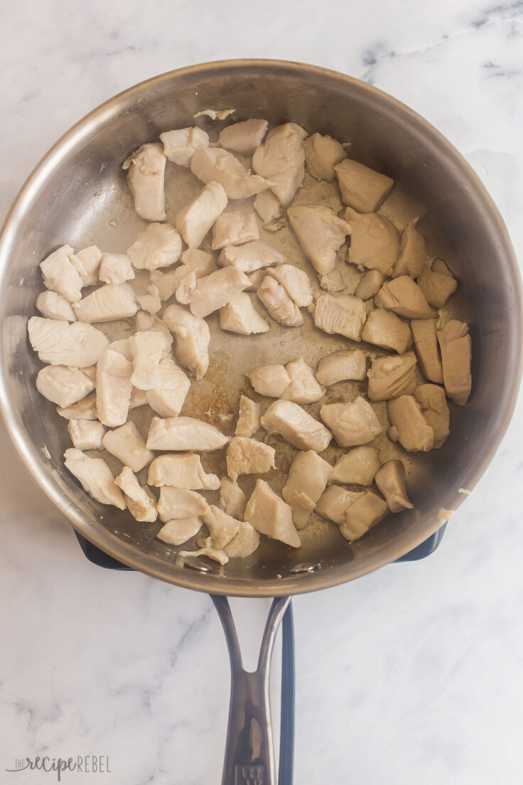 cubed chicken breast cooking in pan