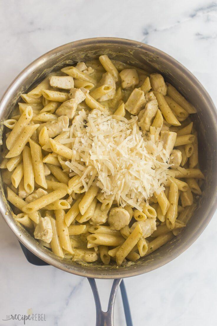 parmesan cheese added to chicken pesto pasta