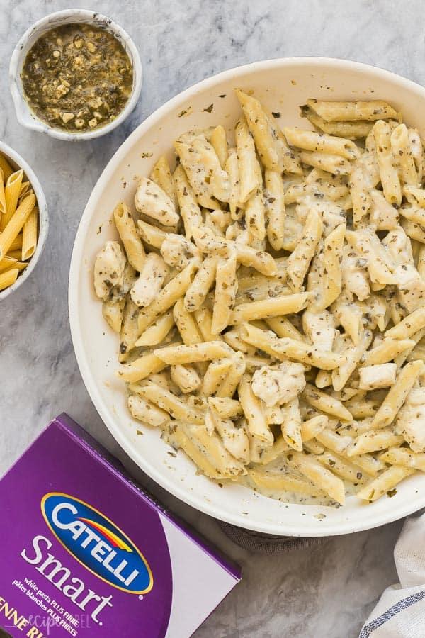pesto chicken pasta with catelli pasta box on grey marble background