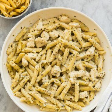 chicken pesto pasta in white pan