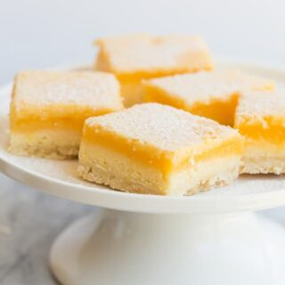 lemon cheesecake bars on white plate