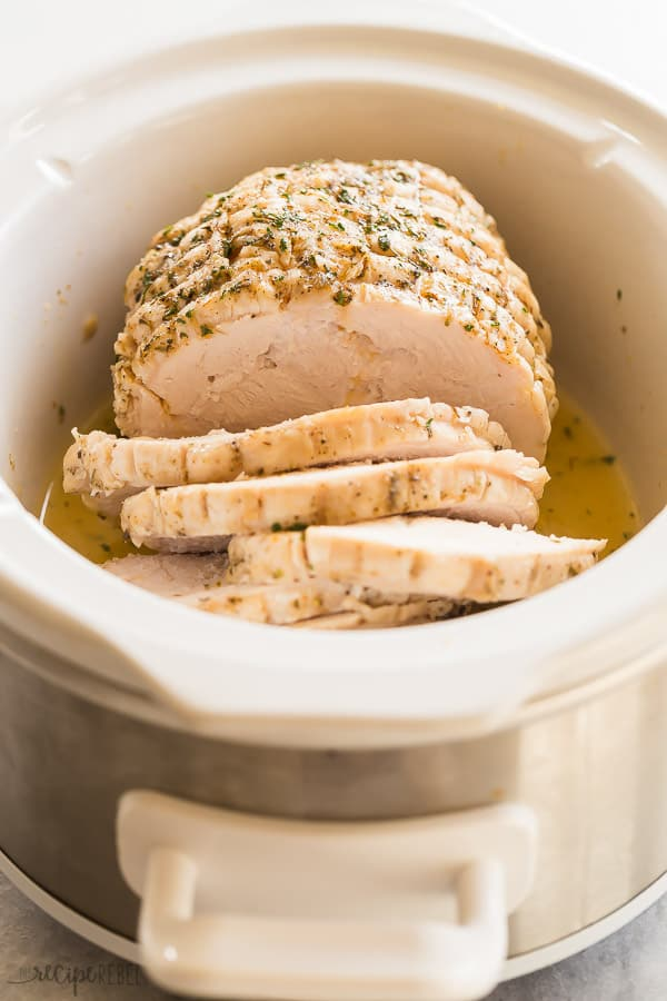 crockpot turkey breast whole in slow cooker with white background