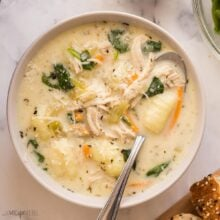 square image of bowl of chicken gnocchi soup with spoon