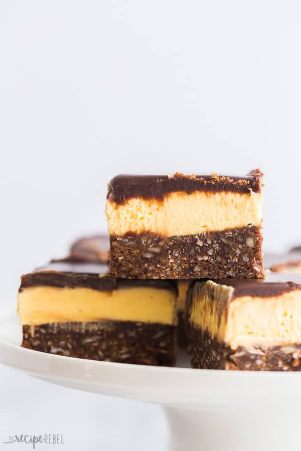 nanaimo bars close up pieces stacked on white plate