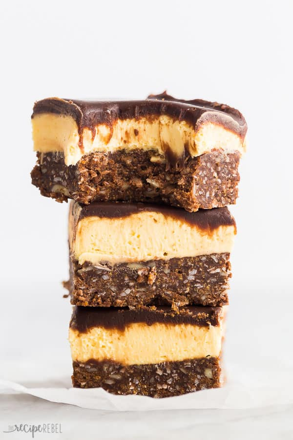 nanaimo bars stack of 3 with one bite taken out of the top bar