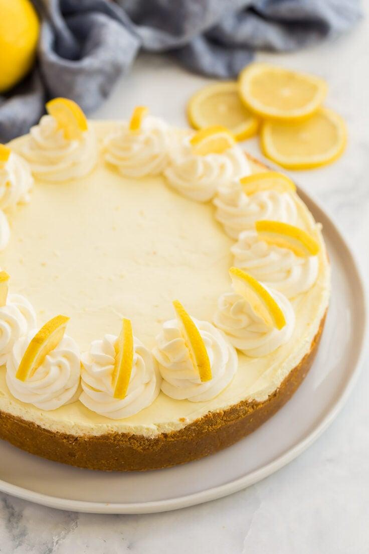 whole no bake lemon cheesecake with whipped cream