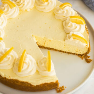 featured image of no bake lemon cheesecake with slice missing