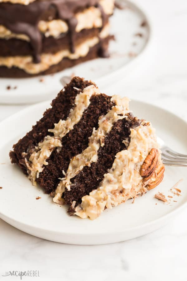 slice of german chocolate cake on white plate on white background