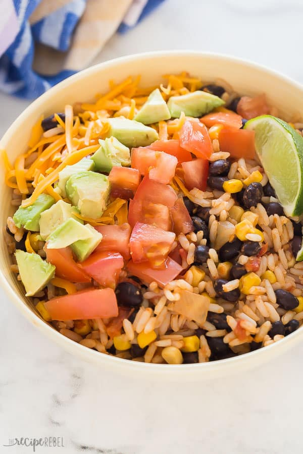 vegetarian burrito bowl with fresh tomatoes, avocado and shredded cheese