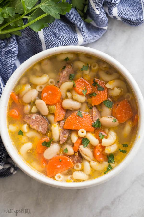 white minestrone with sausage in a bowl overhead close up