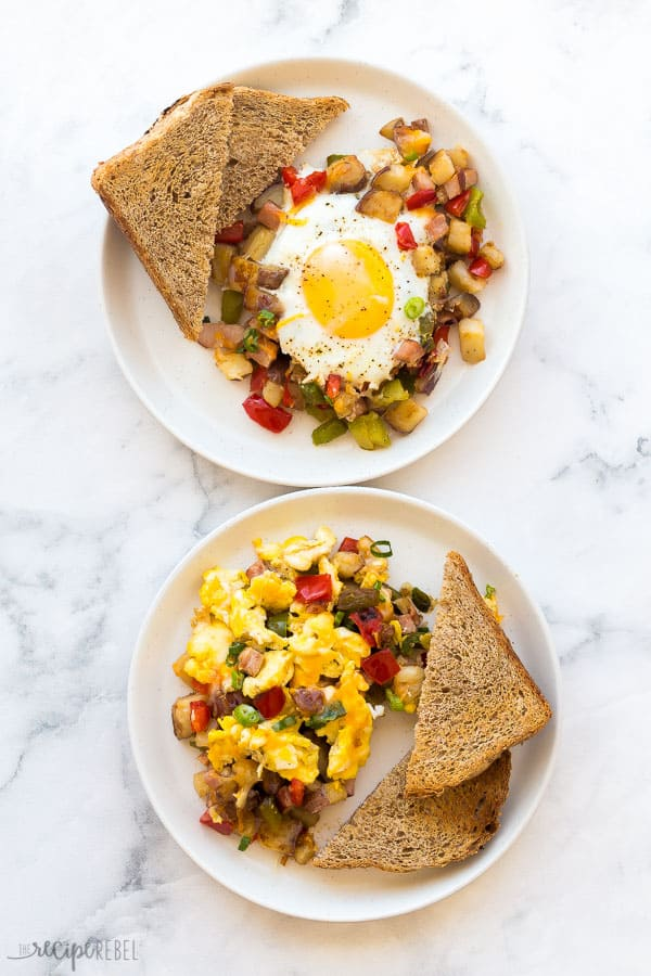 breakfast skillet eggs two ways with toast on white plates on white marble background