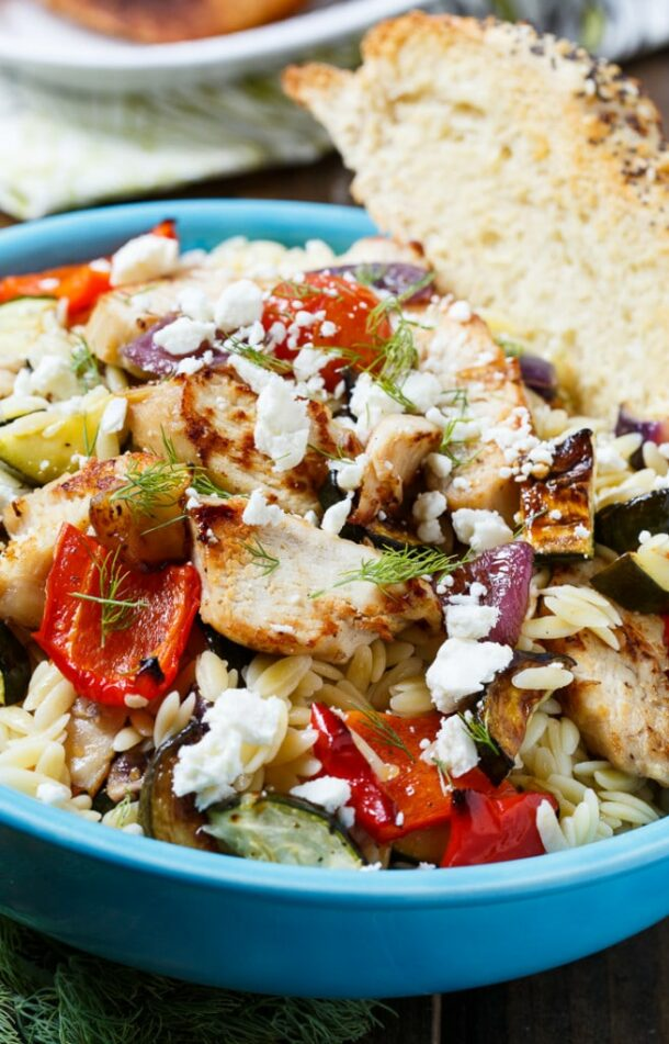 orzo pasta salad with chicken in blue bowl