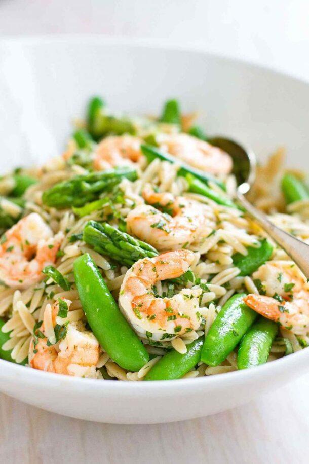 shrimp pasta primavera pasta salad in white bowl