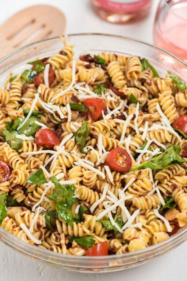 spicy italian pasta salad close up in glass bowl
