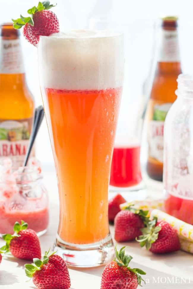 Strawberry Rhubarb Shandy in pilsner glass