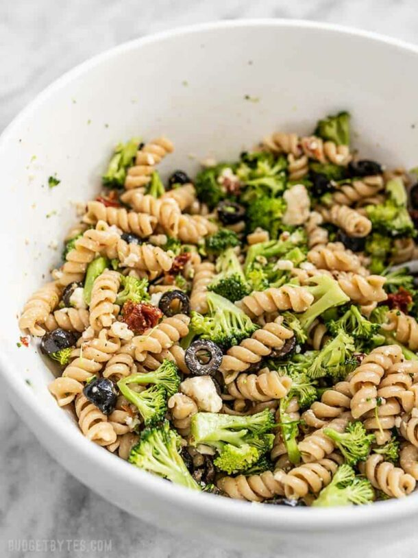 sweep the kitchen pasta salad with rotini in white bowl