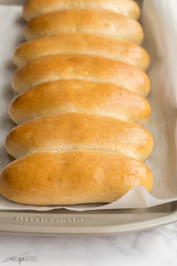 hot dog buns lined up on sheet pan