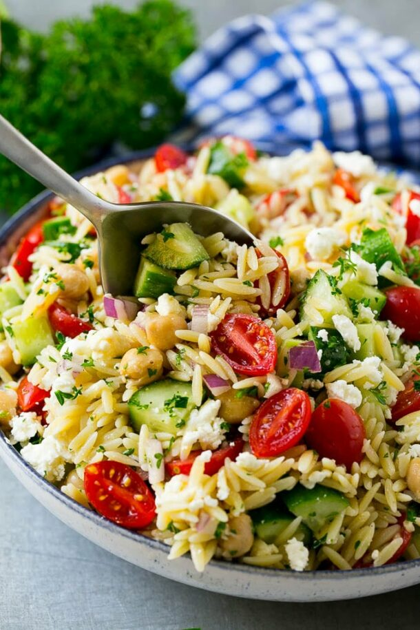orzo pasta salad with cherry tomatoes close up