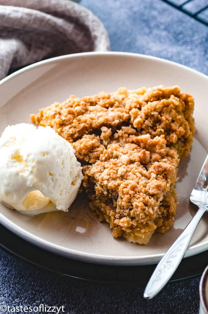 Rhubarb Crisp Pie Recipe with Butter Oatmeal Crumbs and scoop of ice cream