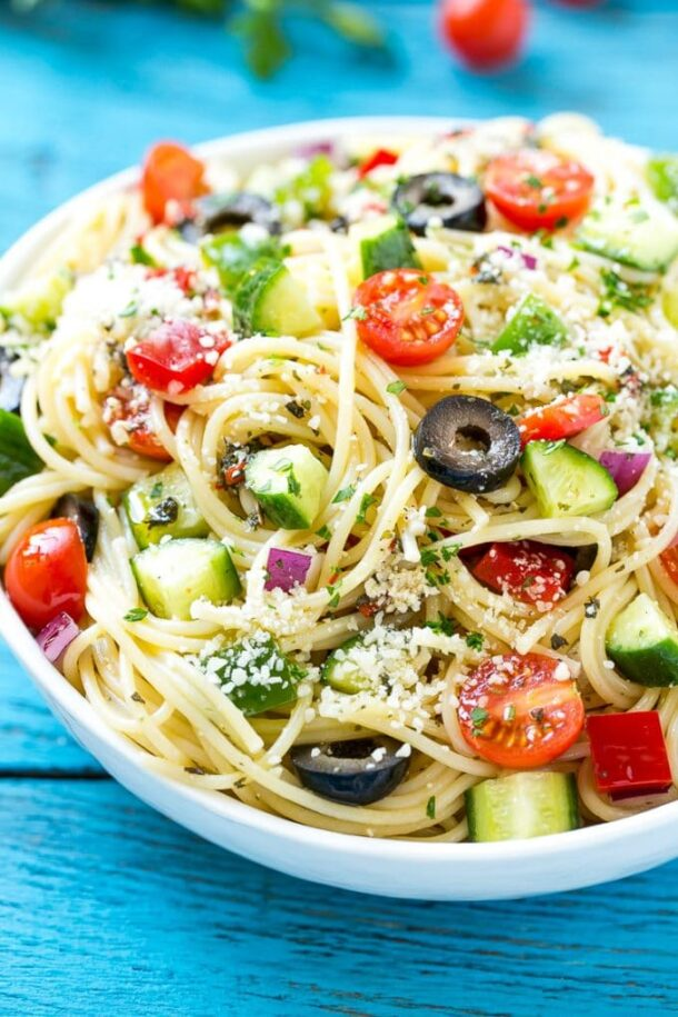 spaghetti salad close up with bright blue background