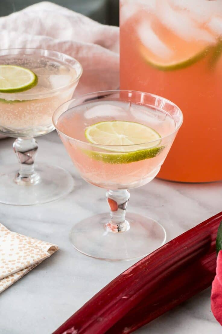 Sparkling Rhubarb Margarita in glasses with pitcher