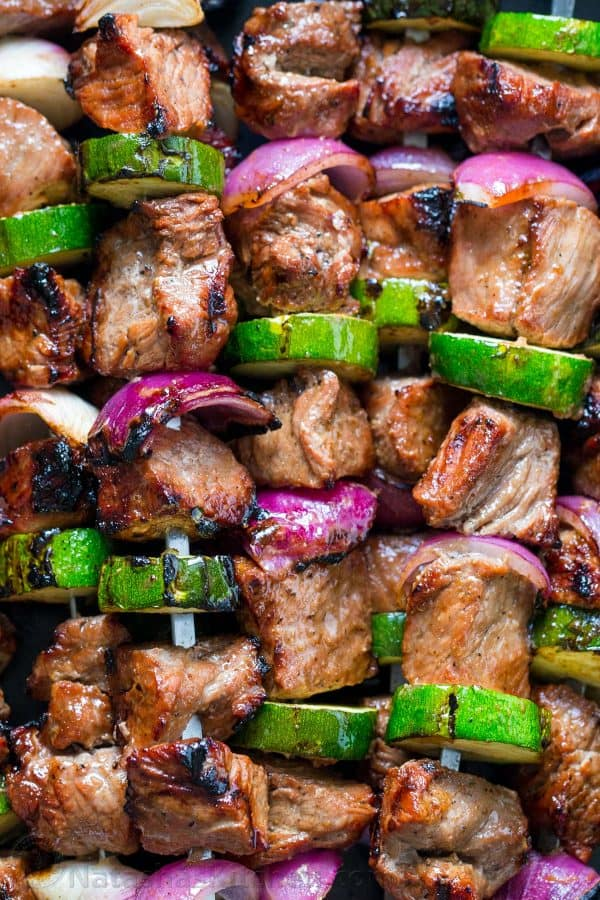 Steak kabobs with purple onion and zucchini close up