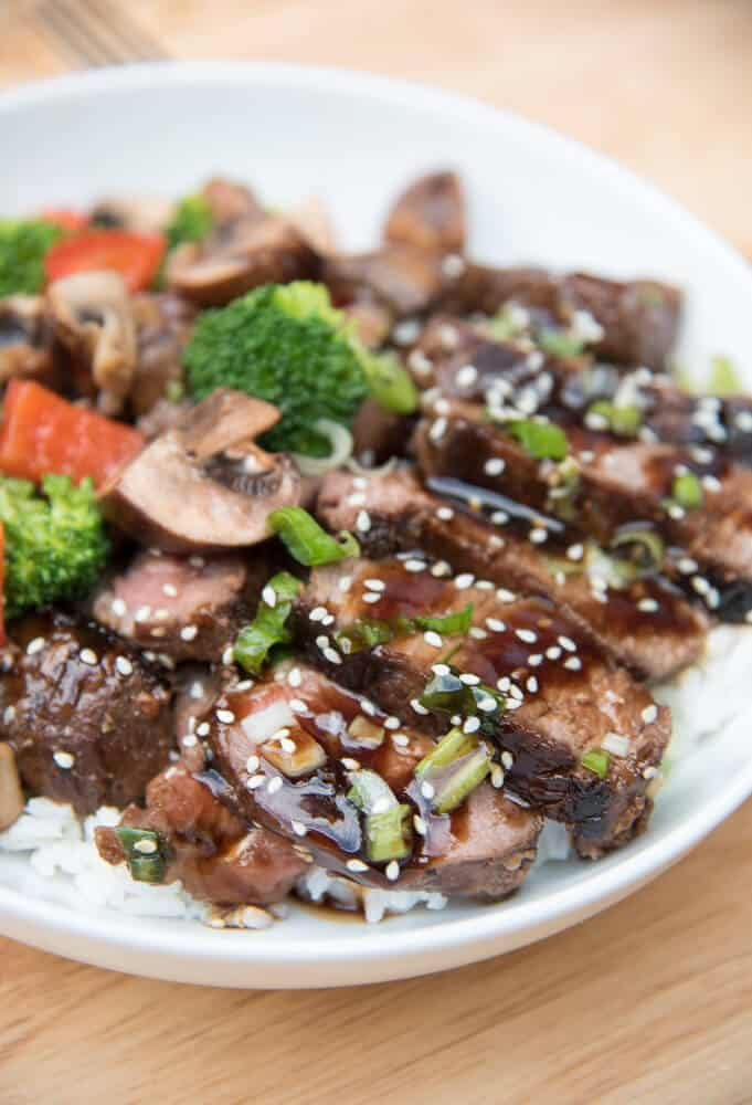 Steak sliced with Asian veggies topped with sesame seeds