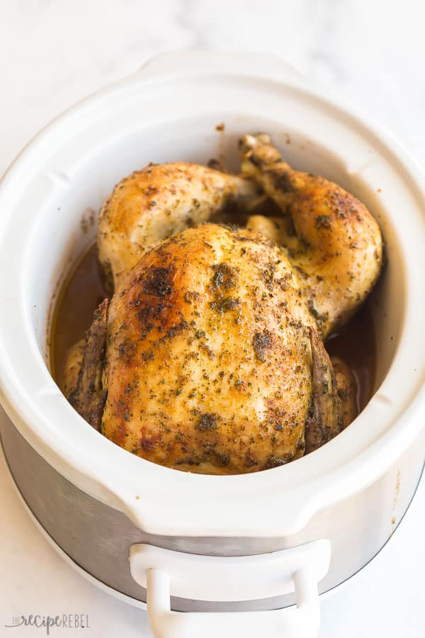 crockpot whole chicken in white slow cooker