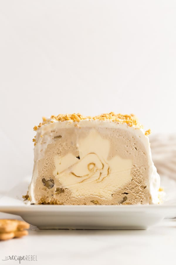 maple ice cream cake sliced on white plate with white background