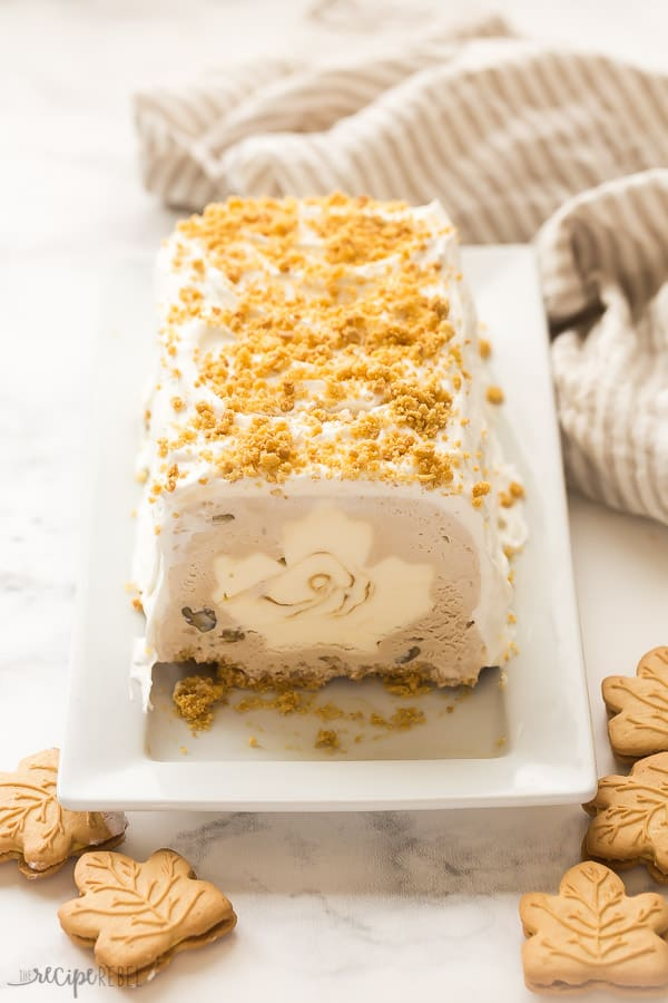 maple ice cream cake on white plate with white background and maple cookies