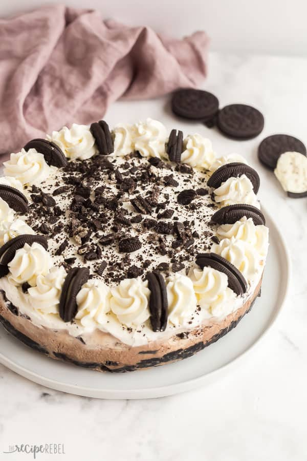 oreo ice cream cake whole with whipped cream and halved oreos