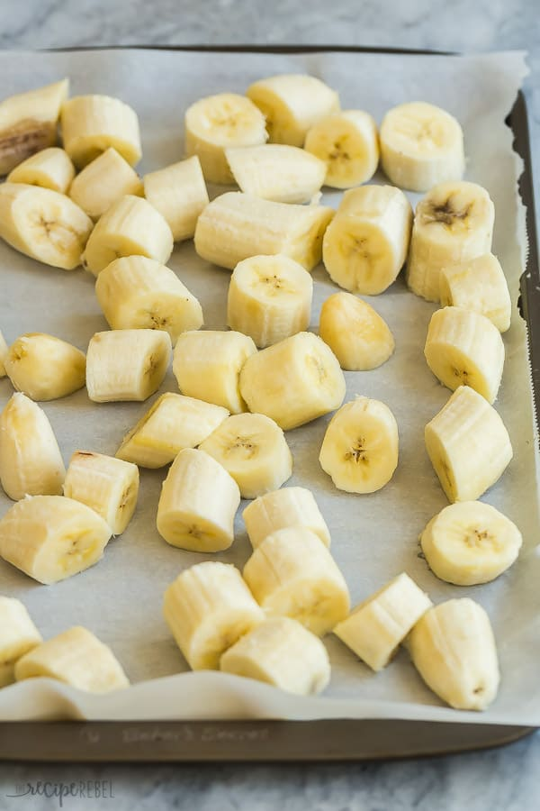 banana chunks on parchment lined baking sheet ready to freeze