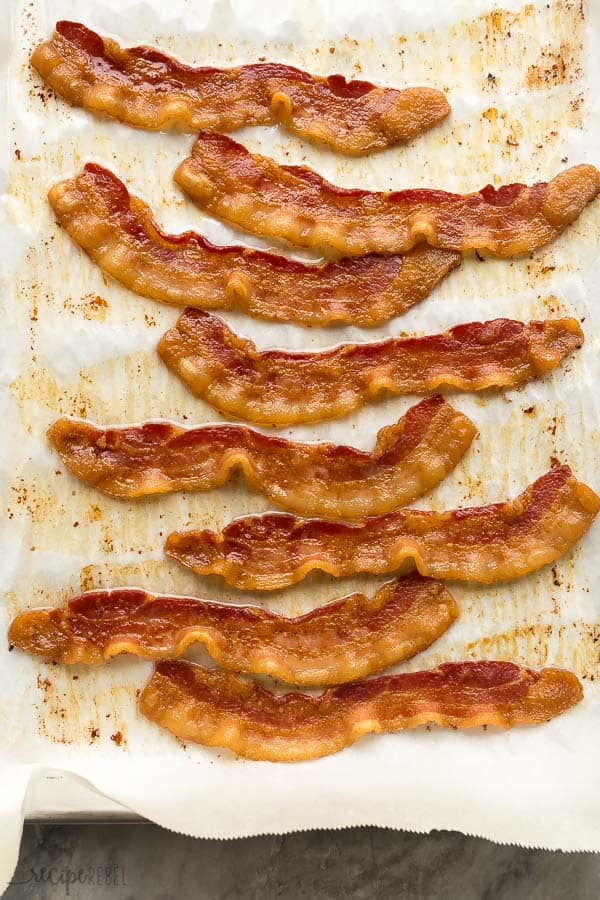 oven baked bacon on a sheet pan with parchment paper overhead