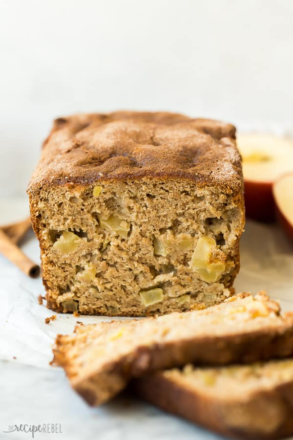 apple bread on marble background with two slices cut