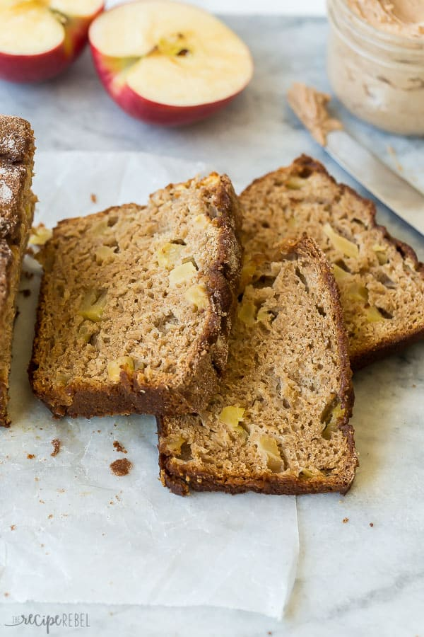 three slices cut from apple bread laying on parchment paper