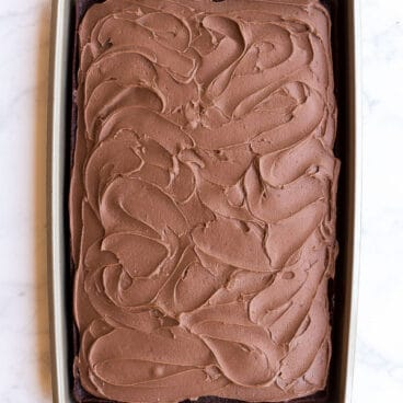 overhead image of chocolate sheet cake in pan with frosting