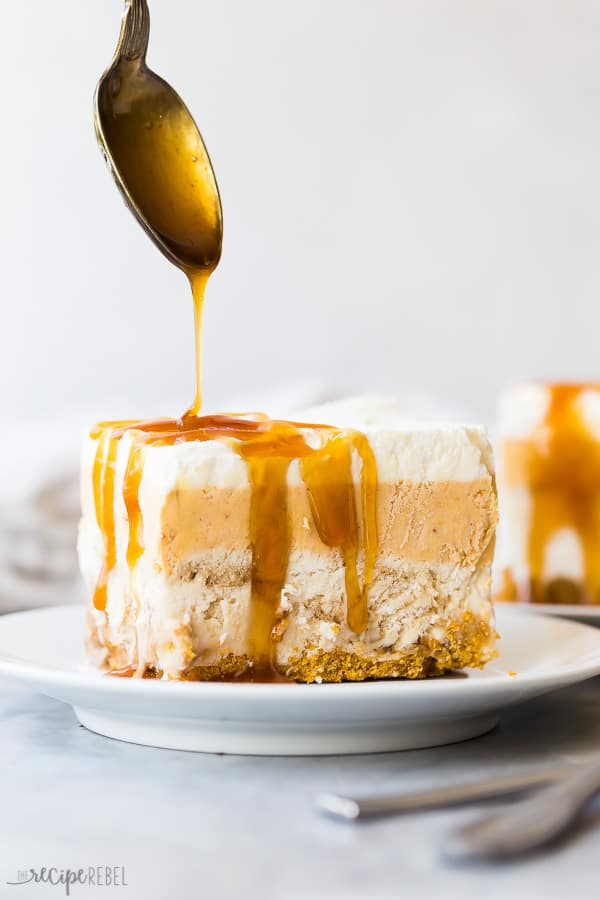 piece of frozen pumpkin dessert with a drizzle of butterscotch syrup