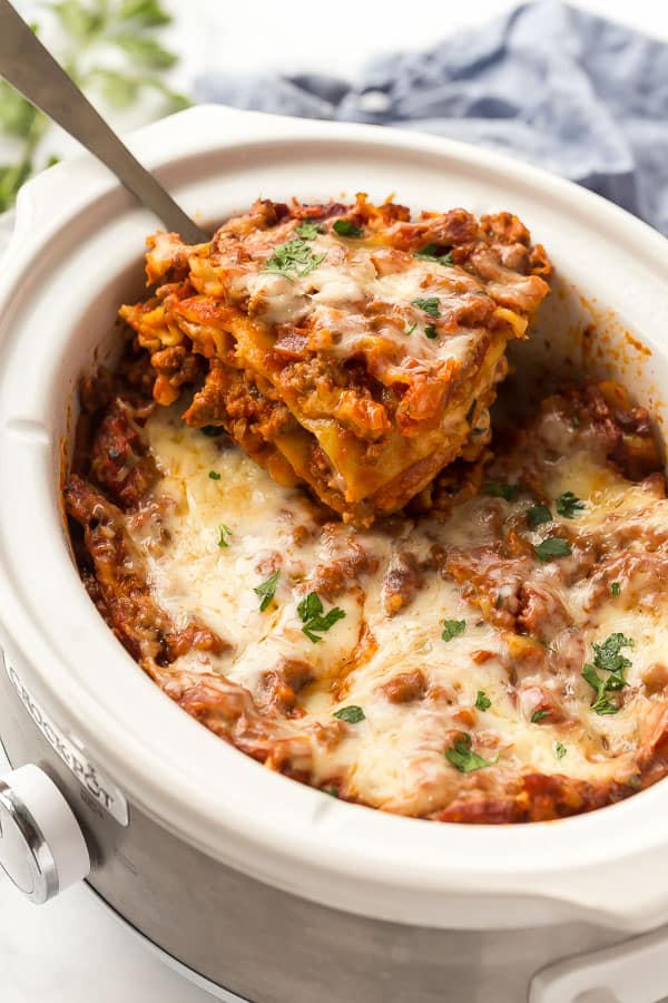 slice of lasagna being lifted out of crockpot