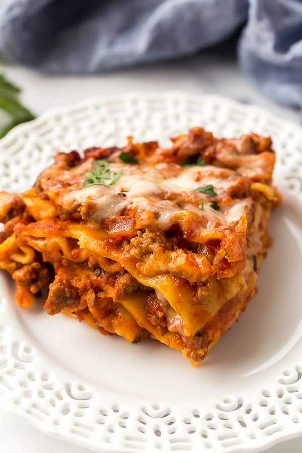 piece of slow cooker lasagna on white plate