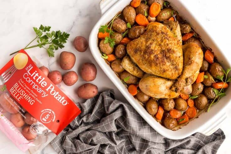 roast chicken and vegetables with bag of little potatoes