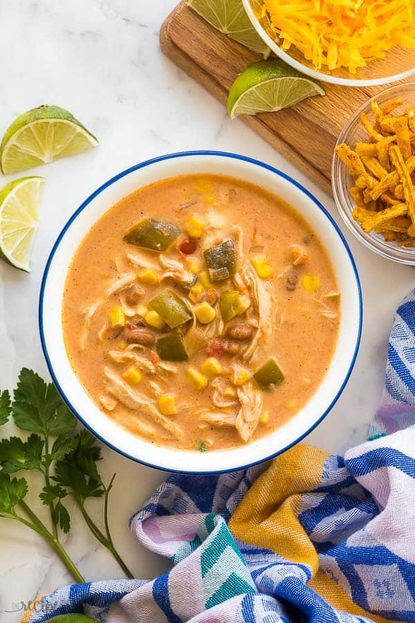 overhead image of creamy chicken taco soup in white bowl