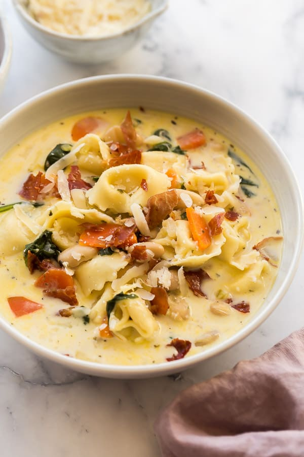 close up image of spinach tortellini soup in bowl