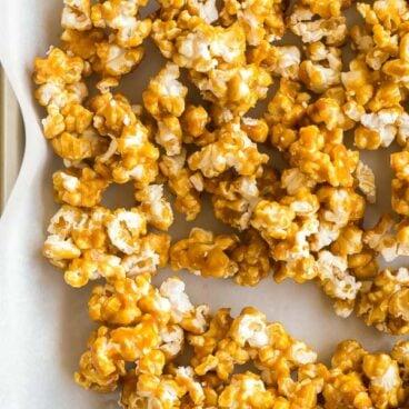 close up image of caramel corn on pan