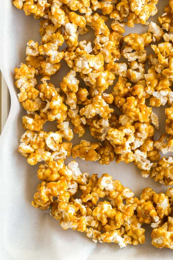 close up image of caramel corn on pan