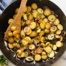 overhead image of lyonnaise potatoes in black skillet