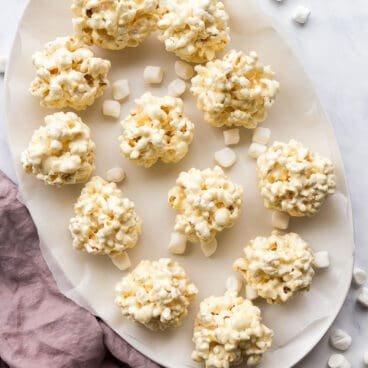 overhead image of popcorn balls on white platter