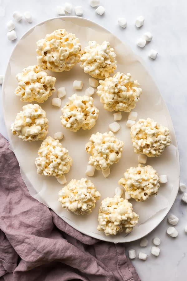 overhead image of popcorn balls on white platter