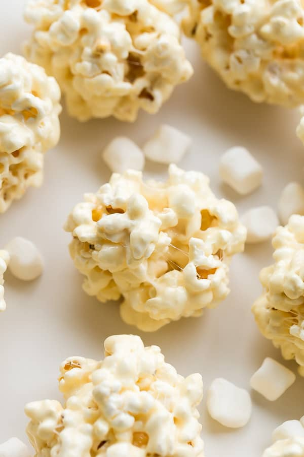 close up image of popcorn ball with marshmallows around